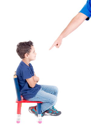little boy being punished isolated in white