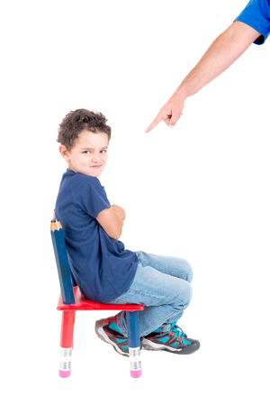 argue kid: little boy being punished isolated in white