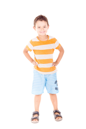 little boy with beach shorts isolated in white background