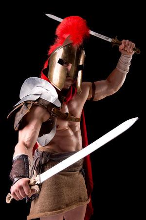 gladiator posing isolated in dark Stock Photo