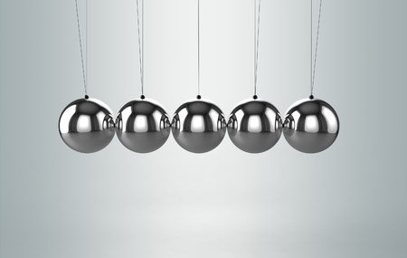 Newtons cradle balancing balls photo