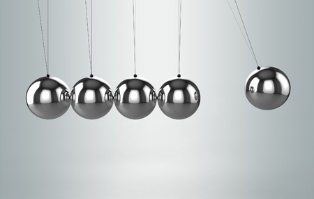 Newtons cradle balancing balls photo