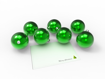 Christmas green baubles and white christmas card for the wishes