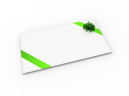 Blank greeting card (for greeting or congratulation) with green ribbon and bow photo