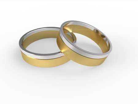 Golden and silver wedding rings isolated on white background