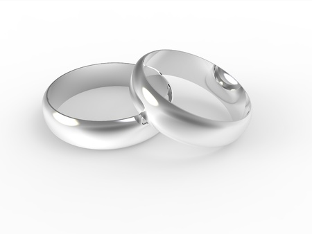 Silver wedding rings isolated on white background photo