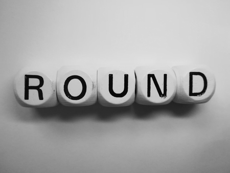 spelling of word round using dice on white background Stock Photo