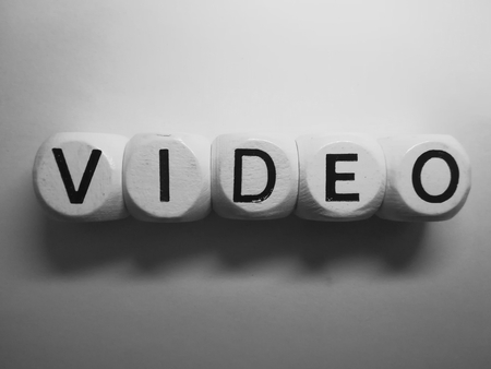 spelling of word video using dice on white background Stock Photo