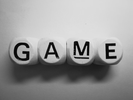 spelling of word game using dice on white background