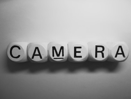 spelling of word camera using dice on white background Stock Photo