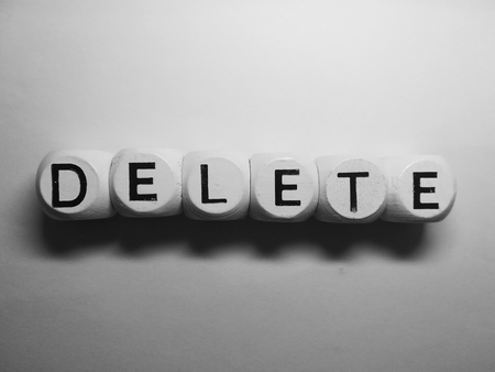 spelling of word delete using dice on white background Stock Photo