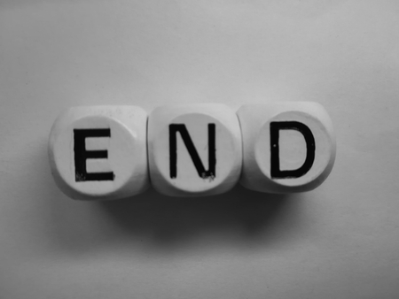 spelling of word end using dice on white background Stock Photo