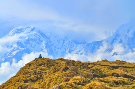 Young woman admires by view in Himalayan mountains. Beautiful Mountain Landscape in Annapurna region, Nepal Stock Photo