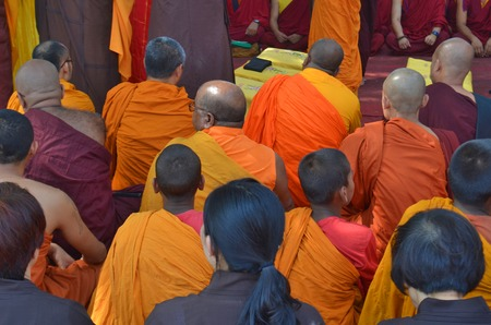 occiput: Buddhist devotees on ceremony, back of the head view.