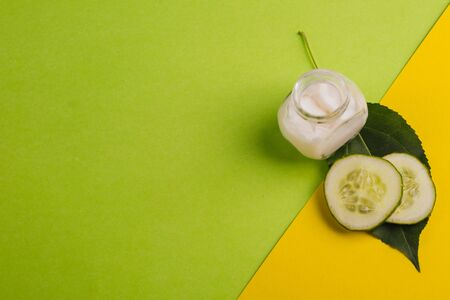 White cucumber cream on a yellow-green background.