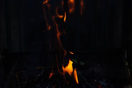 Flames on a dark background.