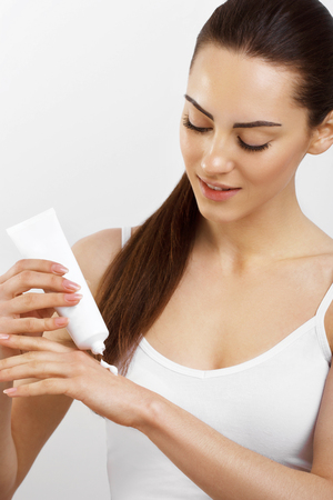 Close Up Of Female Hands Holding Cream Tube, Applying Cosmetic Hand Cream On Soft Silky Healthy Skin.