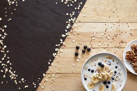 Healthy breakfast bowl: oatmeal with banana, chia seeds, cinnamon, walnuts and honey