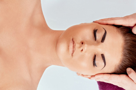 Face Massage. Close-up of a Young Woman Getting Spa Treatment. Spa skin and body care. Facial beauty treatment.Cosmetology.Relaxing