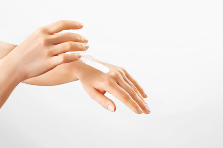 Healthy Young Hands.Female applying moisturizer to her Hands.