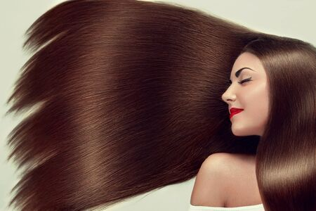 Beautiful Hair. Beauty woman with luxurious long hair. Beauty Model Girl with Healthy brown Hair. Pretty female with long smooth shiny straight hair. Hairstyle. Keratin straightening.