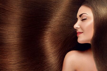 Beautiful Hair. Beauty woman with luxurious long hair as background. Beauty Model Girl with Healthy brown Hair. Pretty female with long smooth shiny straight hair. Hairstyle. Keratin straightening. 写真素材