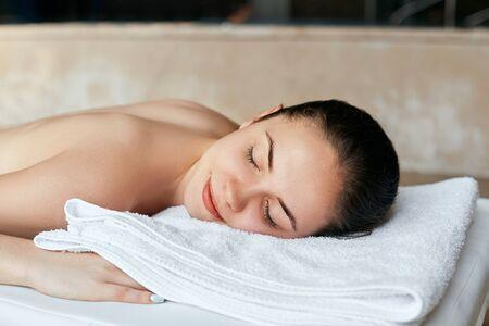 Massage. Beautiful girl in spa salon