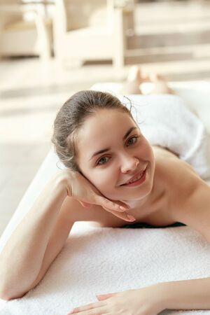 Portrait of young beautiful woman in spa environment. Body care. Spa body. Cosmetology. Massage