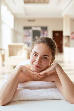 Beautiful woman  relaxing in spa salon. Spa Massage. Body care. Spa body. Cosmetology. Girl having massage in the spa salon Stock Photo - 128748008