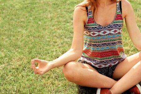 Young woman meditates while practicing yoga. Freedom concept. Calmness and relax, woman happiness. Stock fotó