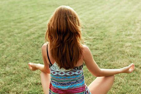 Young woman meditates while practicing yoga. Freedom concept. Calmness and relax. Beauty woman doing yoga. Healthy and yoga concept. Fitness and sports