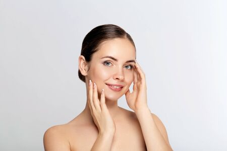 Beautiful Young Woman with Clean Fresh Skin. Face care. Facial  treatment. Cosmetology, beauty and spa