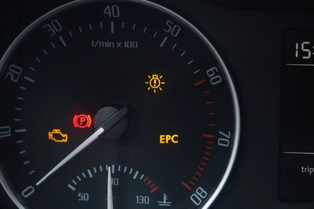 Tachometer dial with needle showing zero rpm with diagnostic icons isolated on black background