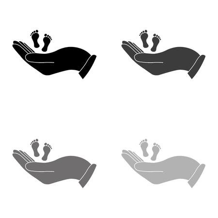 hand holds baby leg - black vector icon