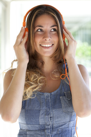 Light bulb in hands of a woman close up Stock Photo