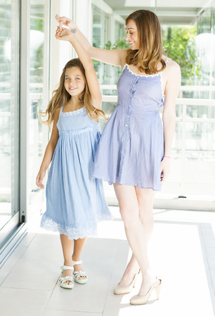 10 11 years: Cute happy mother and daughter looking at camera Stock Photo