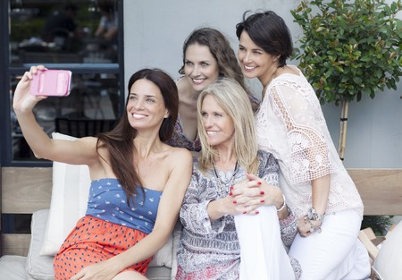 40 45: Happy Female Friends Taking Selfie in Outdoors