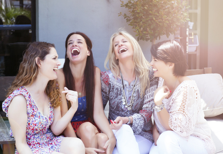 having lunch: Happy group of female friends having fun outdoors