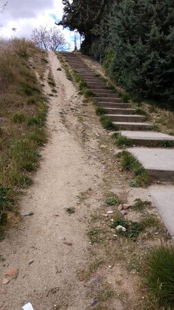 steep sandy slope with wooden stairs