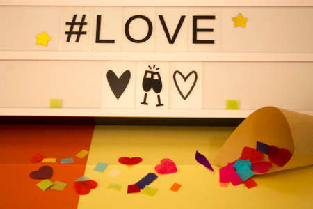 love poster with stars, confetti and hashtag