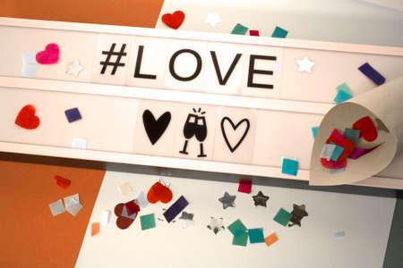 light poster with stars, confetti and hashtag Banco de Imagens