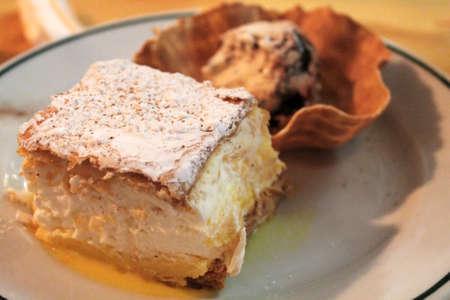 meringue and cream puff pastry with ice cream tart