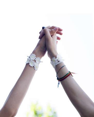 girls with daisy bracelets raising hands