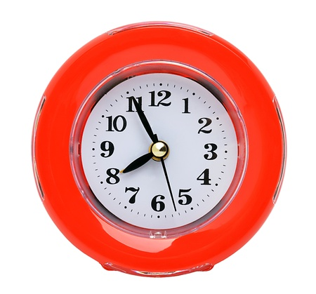Red clock isolated on the white background