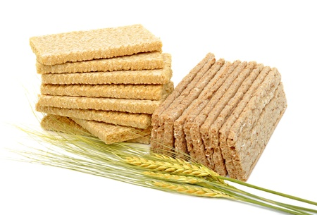 Dry loaves and ears of wheat isolated on the white background photo