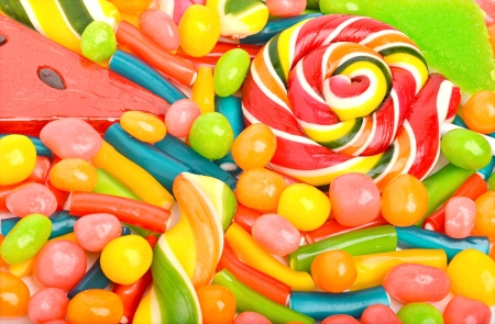 candy background: Bright sweets, lollipops, dragee, candies and jelly sweets