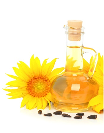 Carafe with vegetable oil and sunflowers isolated on the white background Stock Photo - 18853503