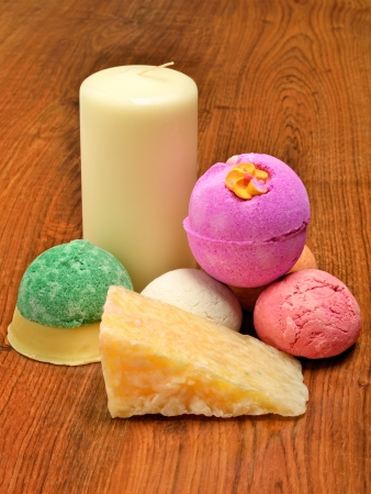 Candle, soap,  bath bombs on the wooden background