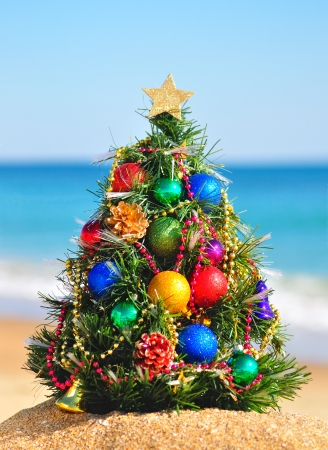 Christmas tree on the sand in the beach Standard-Bild