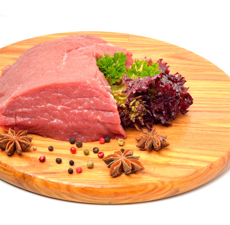 Raw beef and lettuceon the wooden board isolated on white photo